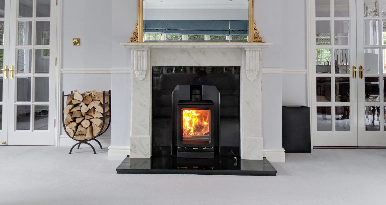 Stovax Vogue, marble surround with polished granite hearth, Sutton.